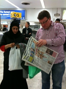 Baggage reclaim at Heathrow: Anjum & Chris re-entering UK life