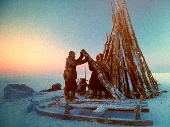 From an old colleague, a card supporting Survival International , who work for tribal people's rights worldwide.  These are Dogan nomads stacking their wood for the night in Siberia.