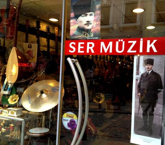 Turkey's hero founder Attaturk on the door of a music shop.